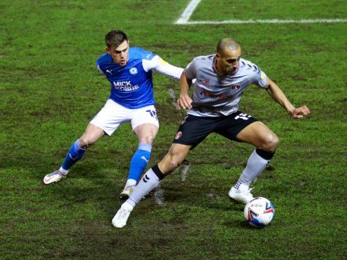 Peterborough's Sammie Szmodics, left, and Charlton's Darren Pratley battle for the ball (Tim Goode/PA)