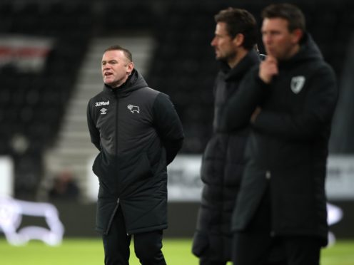 Wayne Rooney (left) secured his first win since taking permanent charge of Derby (Nick Potts/PA)