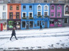 People walk through the snow along Victoria Street in Edinburgh (Jane Barlow/PA)