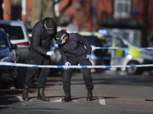 Police officers at the scene in Linwood Road, Handsworth, Birmingham, where 15-year-old Keon Lincoln was fatally attacked (David Davies/PA)