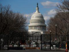 National Guard troops walk outside the Capitol (Rebecca Blackwell/AP)