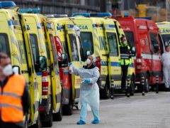 Ambulances queue outside a hospital in Lisbon (Armando Franca/AP)