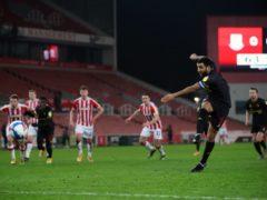 Watford's Troy Deeney scores from the penalty spot (Nick Potts/PA).