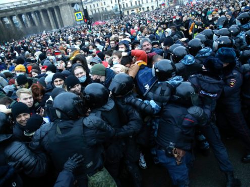 People clash with police during a protest against the jailing of opposition leader Alexei Navalny in St Petersburg (AP)