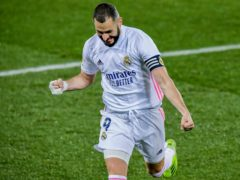Karim Benzema celebrates after the first of his two goals (Alvaro Barrientos/AP)