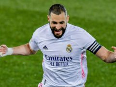 Karim Benzema scored a brace as Real Madrid returned to winning ways (Alvaro Barrientos/AP)