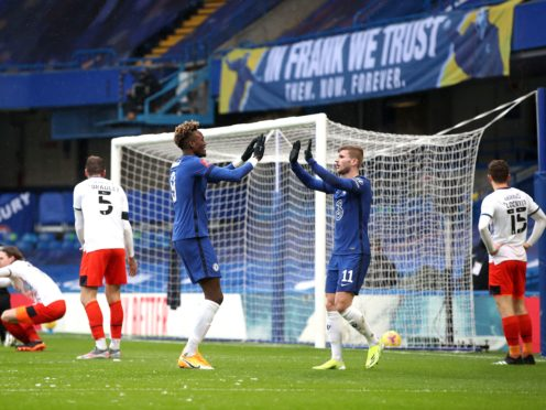 An 'In Frank we trust' banner is displayed behind the goal as Chelsea's Tammy Abraham (centre) celebrates the first goal of his hat-trick against Luton with team-mate Timo Werner at Stamford Bridge.