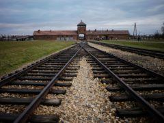 The railway tracks leading to the Auschwitz Nazi death camp in Poland (Markus Schreiber/AP)