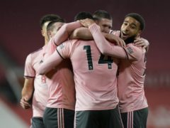 Sheffield United's Oliver Burke (14) celebrates with his team-mates after scoring the winner at Old Trafford (Tim Keeton/PA)