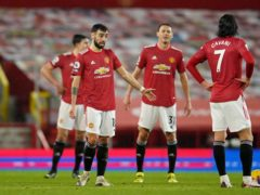 Manchester United's players appear dejected during their home defeat to Sheffield United (Dave Thompson/PA)