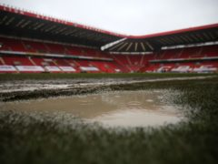 A view of the waterlogged pitch at the Valley (Steven Paston/PA)