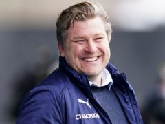 Karl Robinson's side are flying (Tess Derry/PA)