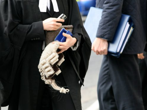 Solicitors' leaders have warned that a two-week suspension of almost all court hearings, including jury trials, may be needed (PA)