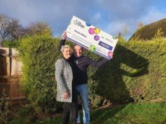Martin Gilbey and his partner Tracy celebrating a £119,000 EuroMillions win (Camelot/PA)