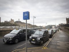 The Scottish Government announced its was changing the criteria for a support grant for taxi drivers (Jane Barlow/PA)