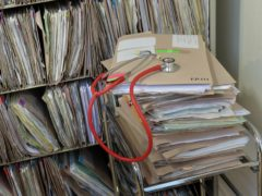 A stethoscope on top of patient's files at the Temple Fortune Health Centre GP Practice near Golders Green, London.
