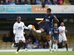 Southend United's Tim Dieng and Peterborough United's Siriki Dembele during the Skybet League One match Roots Hall, Southend.