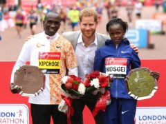 The Duke of Sussex poses with the winner of the men's marathon Kenya's Eliud Kipchoge and women's marathon Kenya's Brigid Kosgei during the 2019 Virgin Money London Marathon (Paul Harding/PA)