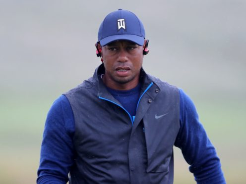Tiger Woods had to be rescued by firefighters after a car crash in California (Niall Carson/PA)