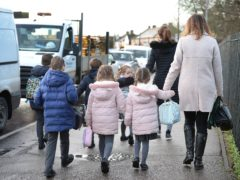 Children in the first three years of primary school are among those due back on February 22 (Nick Ansell/PA)