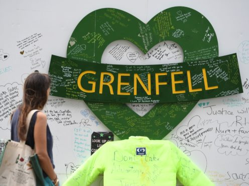 People at the Grenfell Memorial Community Mosaic (Kirsty O'Connor/PA)