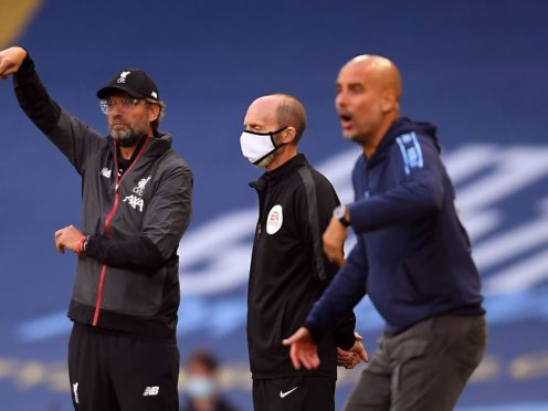 Jurgen Klopp, left, has been surprised by Manchester City's tactics when visiting Anfield (Laurence Griffiths/MNC Pool)