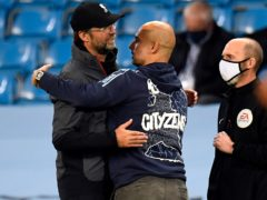 Liverpool manager Jurgen Klopp (left) says chasing Pep Guardiola's (right) Manchester City is not his prime focus (Peter Powell/NMC Pool).