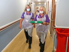 Social care staff were left without PPE as the Government prioritised the NHS, MPs have said (Peter Byrne/PA)