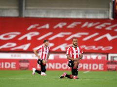 Brentford's Bryan Mbeumo takes the knee before the play-off semi-final second leg against Swansea (John Walton/PA)