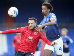 Oldham's Sido Jombati, right, is suspended for the visit of Barrow (Martin Rickett/PA)
