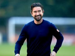 Harry Kewell's Oldham got a point at Tranmere (PA)
