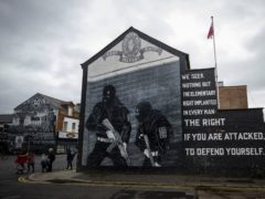 "Ulster Volunteer Force (UVF) mural in support the of Ulster loyalist paramilitary group, on the wall of a property on the Lower Newtownards Road in east Belfast. Paramilitarism remains a ""clear and present danger"" in Northern Ireland, a new report has found. The Independent Reporting Commission (IRC) said it understands from police that there remains thousands of ""signed up"" paramilitary members (Liam McBurney/AP)"