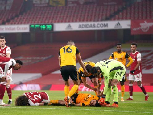 Raul Jimenez (right, floor) fractured his skull after clashing heads with Arsenal's David Luiz in November (John Walton/PA)