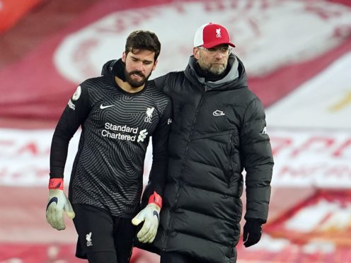 Alisson and Jurgen Klopp have discussed the errors he made in the Manchester City match (Jon Super/PA)