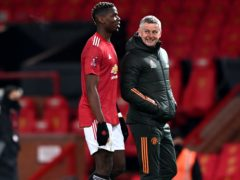 Ole Gunnar Solskjaer, right, says Paul Pogba is enjoying playing for United (Laurence Griffiths/PA)