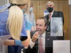 Health Secretary Matt Hancock takes a coronavirus test (Stefan Rousseau/PA)