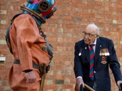 The late Captain Sir Tom Moore with veteran fundraiser Lloyd Scott (Jacob King/PA)