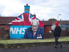Mural tribute to Captain Sir Tom Moore in Belfast (Niall Carson/PA)
