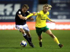 Millwall's Maikel Kieftenbeld and Norwich's Todd Cantwell battle for the ball (Adam Davy/PA).