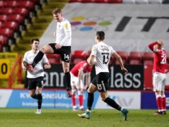 Andy Cannon, centre, celebrates his goal (John Walton/PA)