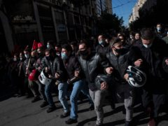 University students wearing protective face masks take part in a rally against education reforms in Athens (Petros Giannakouris/AP)