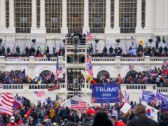 People loyal to Donald Trump breach the Capitol in Washington (John Minchillo/AP)