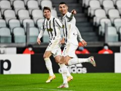Cristiano Ronaldo celebrates after scoring the opening goal in Juventus' 2-0 Serie A win against Roma (Marco Alpozzi/LaPresse via AP)