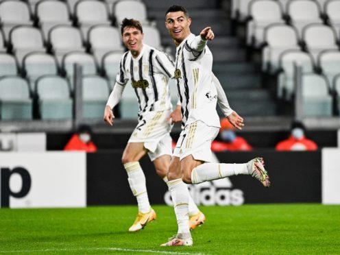 Cristiano Ronaldo celebrates after scoring the opening goal in Juventus' 2-0 Serie A win against Roma (Marco Alpozzi/LaPresse via AP)