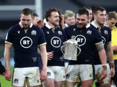 Scotland players with the Calcutta Cup (PA)