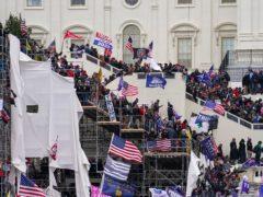 Rioters storm the US Capitol in Washington on January 6 (John Minchillo/AP)