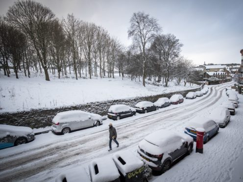 Snow covers the streets in Holyrood, Edinburgh (Jane Barlow/PA)