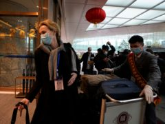 Thea Koelsen Fischer of the World Health Organisation team arriving at Wuhan airport to depart the city after the WHO's recent fact-finding tour ((Ng Han Guan/AP)
