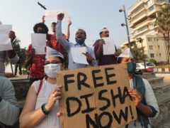 Members of the Aam Aadmi Party demand the release of Indian climate activist Disha Ravi during a protest in Mumbai (Rafiq Maqbool/AP)