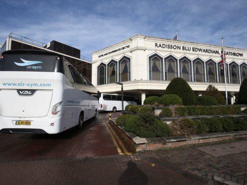 A coach carrying passengers arrives at the Radisson Blu Edwardian Hotel, near Heathrow Airport (Jonathan Brady/PA)